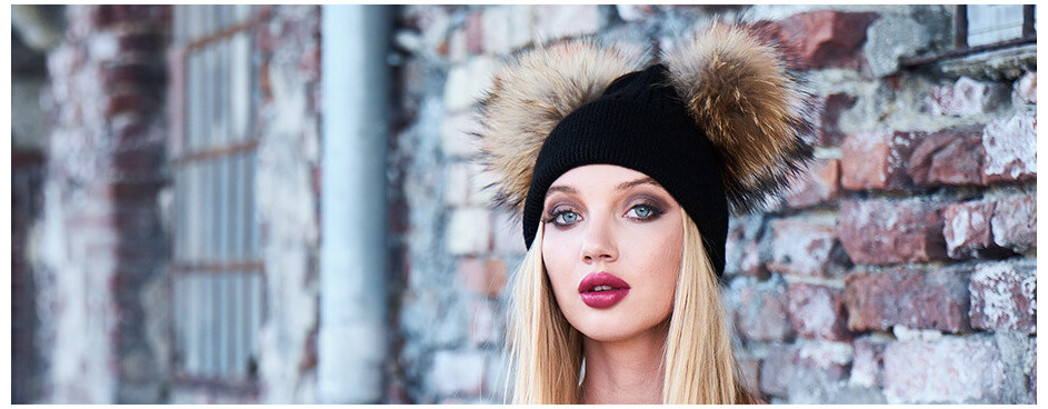 Hats with fur pom poms